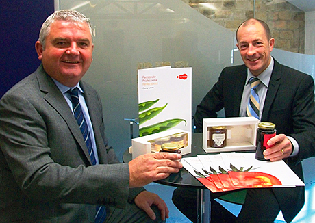 Chris Milnes, left, and PPS managing director Simon Bell with examples of Technocap lids.