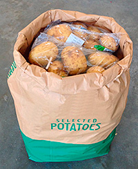 Corner-shop retailers use large sacks as a way to contain and display bulky items.