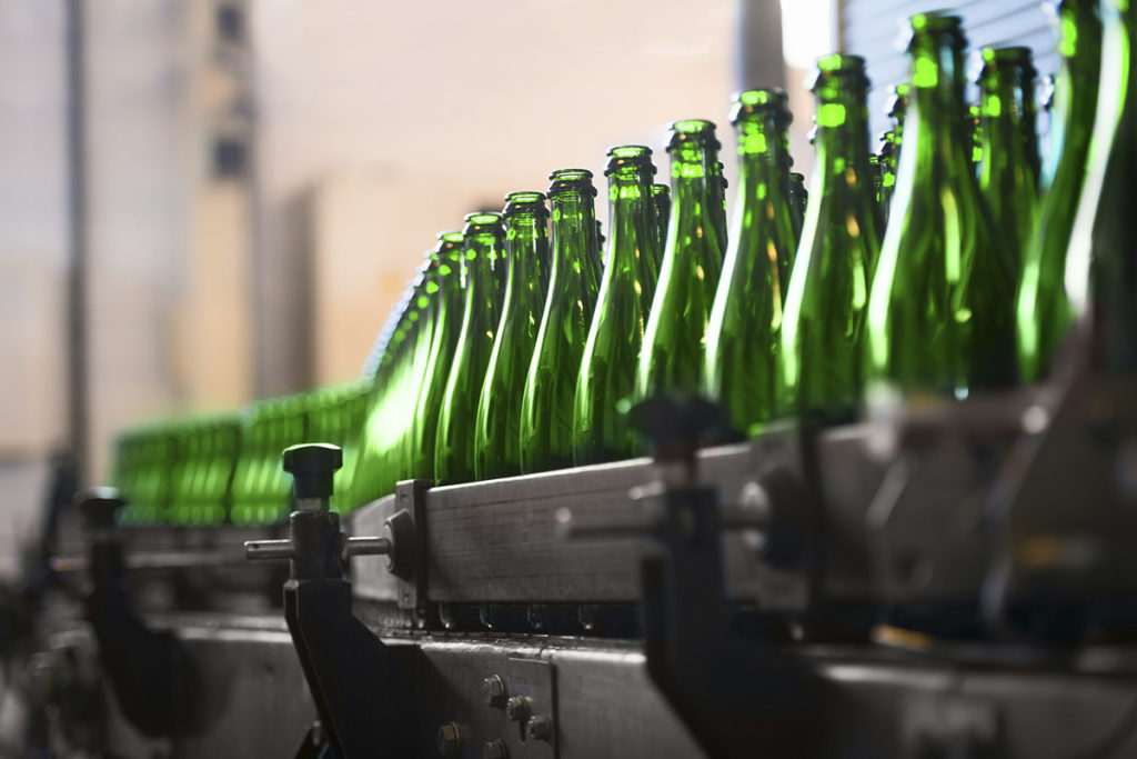 Glass bottles on production line