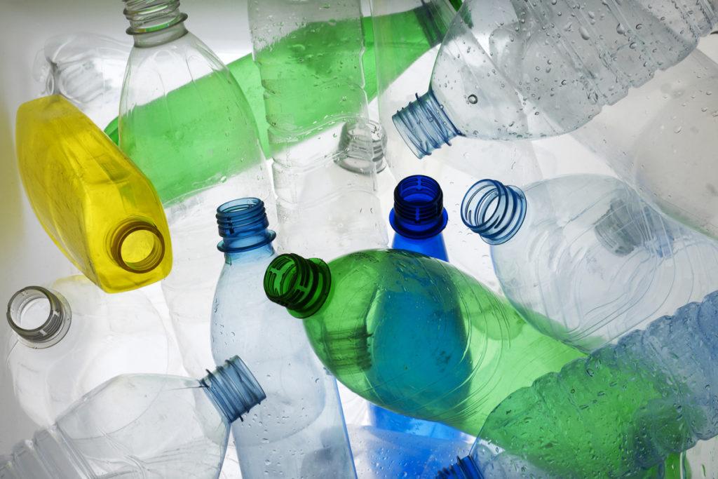 Backlit shot of various plastic bottles