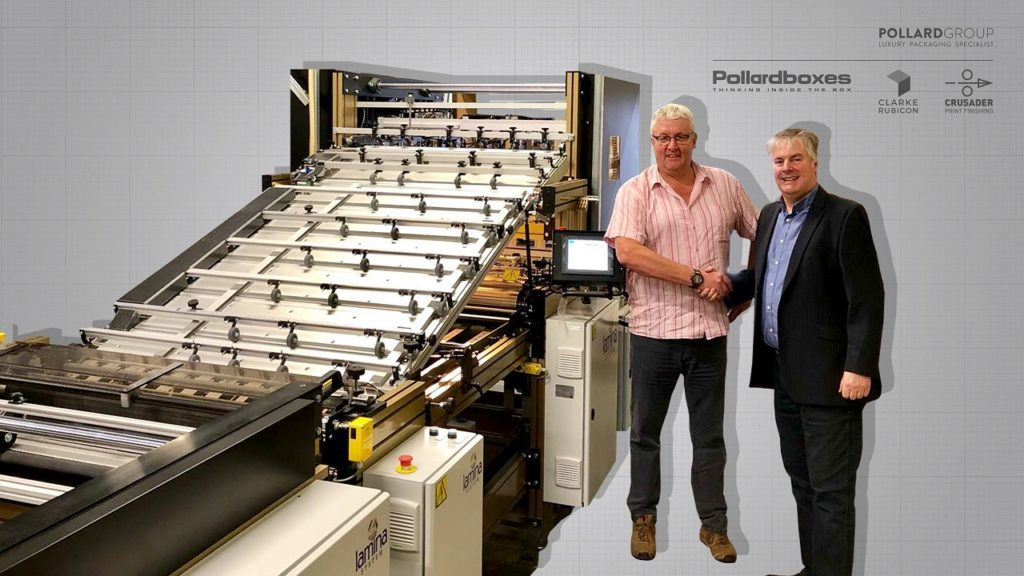 Two men standing in front of machinery